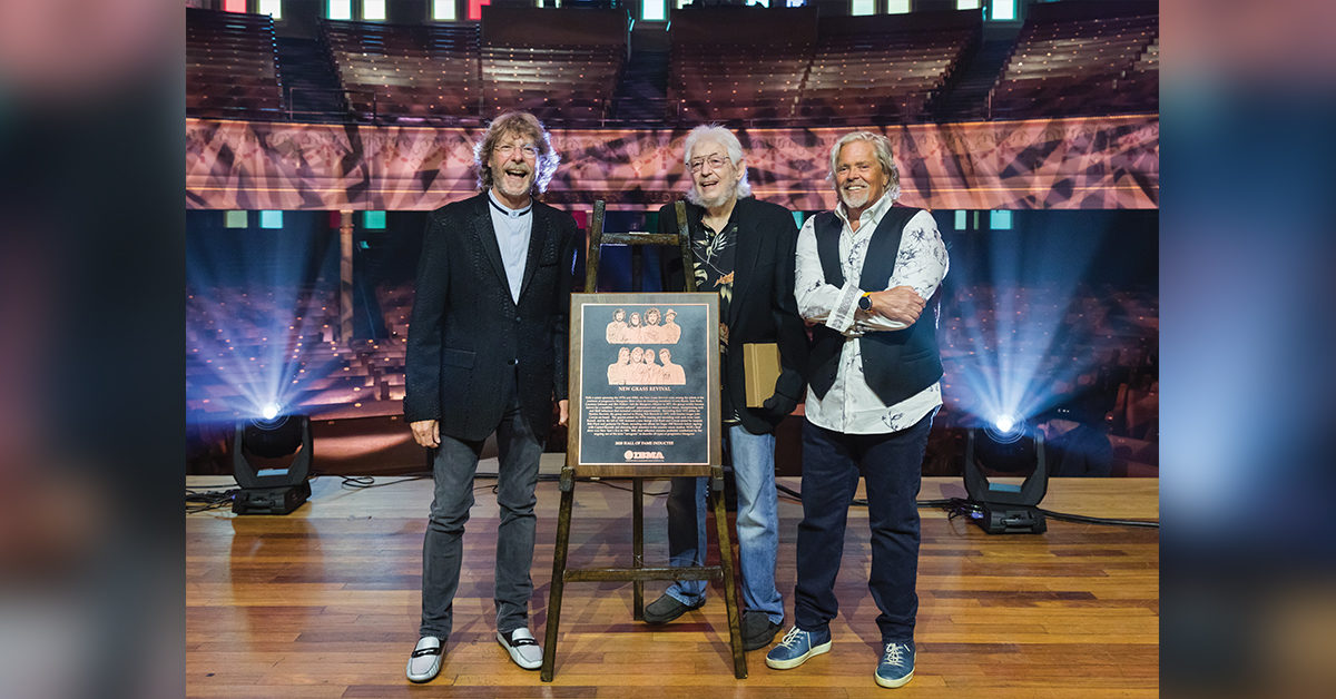 Sam Bush, Curtis Burch, John Cowan of New Grass Revival, smile for a photo