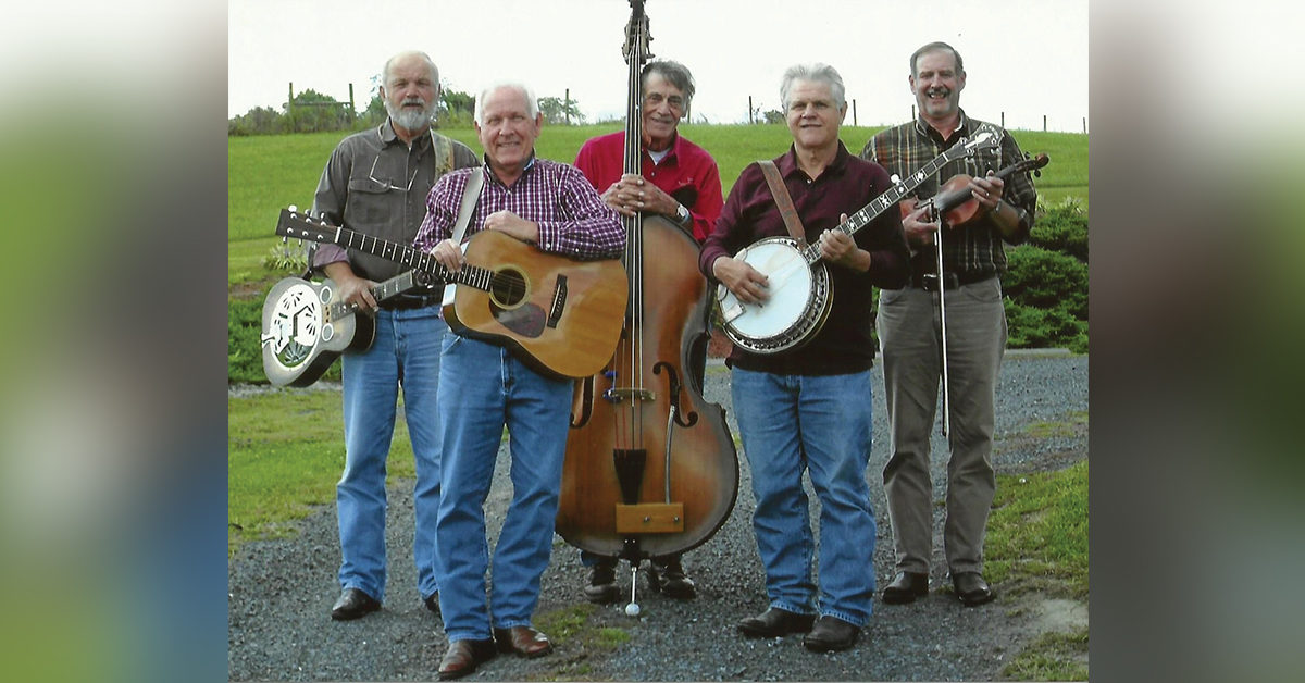 "(left to right) Richard Kleese, Jimmy Drummond, Norman Racey, Richard ""Buggs"" Frank, Jamie Thomas pose for a photo with their instruments"