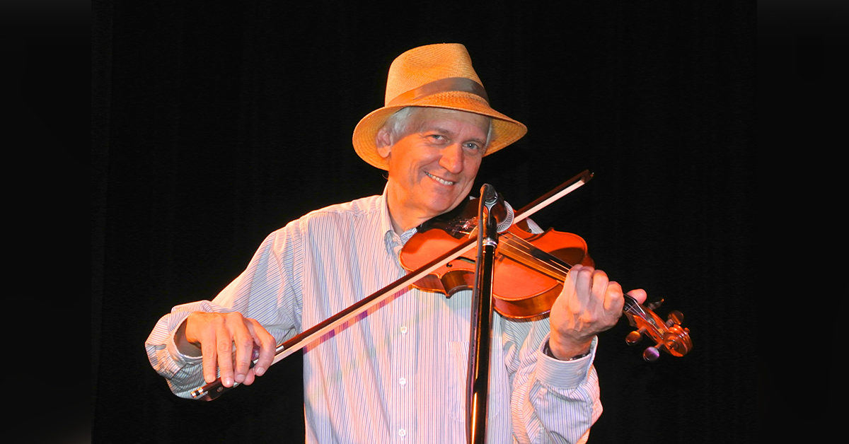 Jack Tuttle playing his fiddle