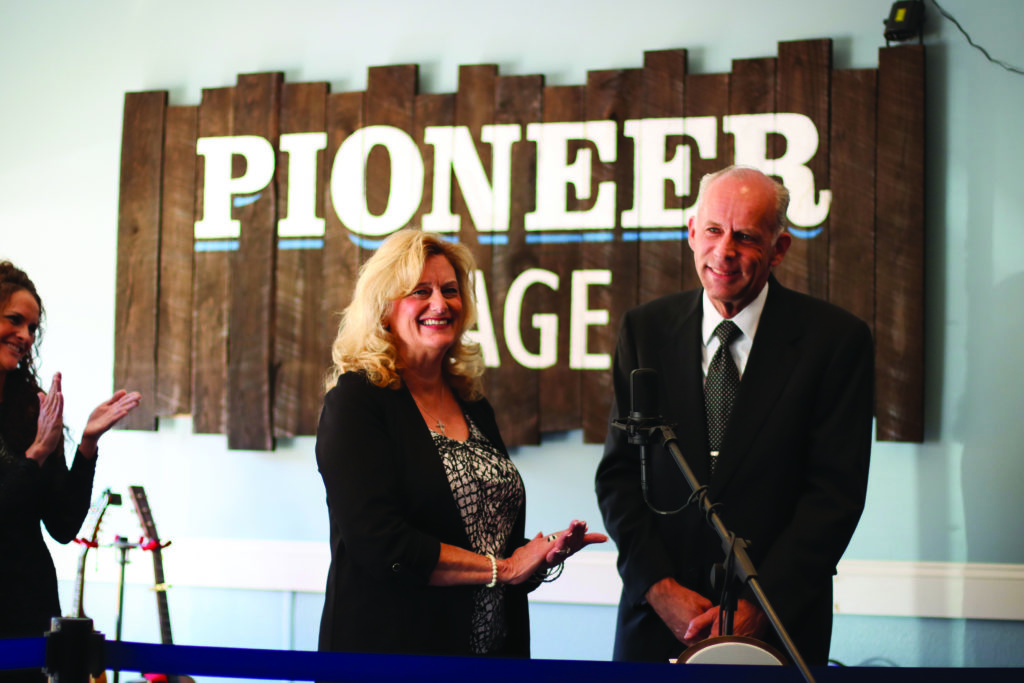 Mr. and Mrs. Eddie Stubbs speaking on the Pioneer Stage speaking to Glenville students and administration members and the community of Glenville on the day they dropped off Eddie's archives.  Photo Courtesy Glenville State College Public Relations